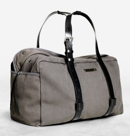 Acne Everest: A canvas shoulder bag with fixed leather straps at the sides and plenty of sporty details. LOVE.