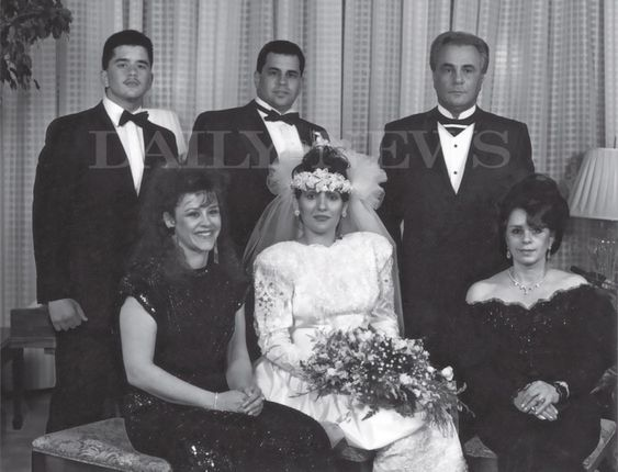 """In this rare photo featured in the book """"Shadow of My Father"""" by John (Junior) Gotti pictures (l. to r. back row) Peter Gotti, John (Junior) Gotti, John Gotti and (front row) Angel Gotti, Kimberly Albanese (Gotti) and Victoria Gotti at the wedding of John (Junior) Gotti in 1990."""