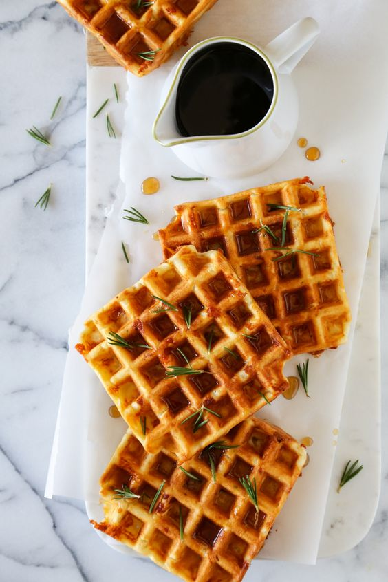 Mouthwatering savory waffles flavored with Dubliner cheese, ham and rosemary. Perfect for a Holiday breakfast!