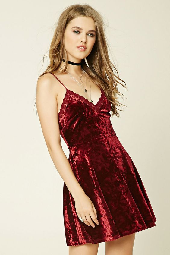 A velvet cami dress featuring adjustable straps, a V-neckline with scalloped…: