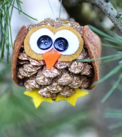 Animal crafts owl and pine cones on pinterest for Pine cone christmas ornaments crafts