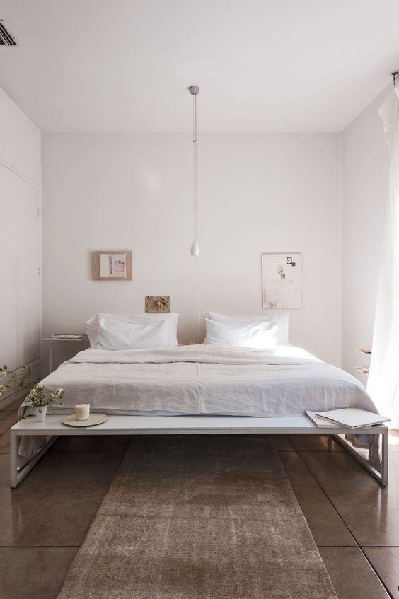 Designer Michaela Scherrer entirely sticks to shades of white in her own Pasadena, California, home—see the Remodelista book for a full exploration. In our post DIY Paint, Scherrer explains how she carefully mixes her palette. Photograph by Matthew Williams for Remodelista. #whitebedroom #serenedecor