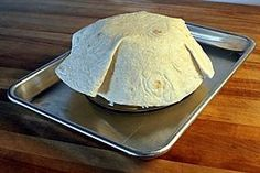 """You don't have to have the fancy """"tortilla pan"""" to make shells for taco salads!  Just put a room temperature tortilla over top of 'or' inside of an oven safe bowl, bake at 375 degrees for 14-16 minutes, or until golden brown. ENJOY!"""