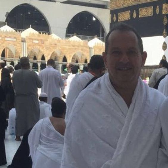 """British ambassador to Saudi Arabia completes hajj after converting to Islam  The British ambassador to Saudi Arabia has converted toIslamand this week completed the hajj with his Syrian wife.  A picture of Simon Collis in the traditional white robes worn by pilgrims during the hajj was posted on Twitter by Fawziah Albakr, of King Saud University. She wrote in Arabic: """"The first British ambassador to the Kingdom leads the pilgrimage after his conversion to Islam: Simon Collis with his wife…"""