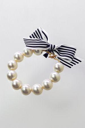 pearl bracelet with navy stripe ribbon tie