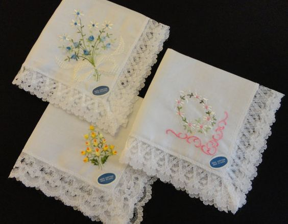 "VINTAGE Hankies 1950s Three white, never used, wide white machine made lace edges, each is machine embroidered with flowers, ""Made In Japan"""