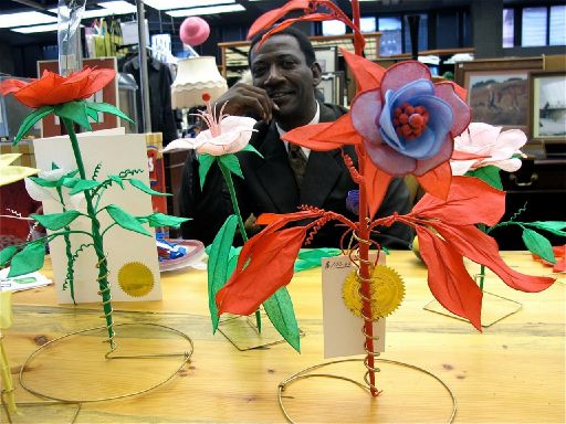 I met this guy in Portland at Powell's book store, sitting in the coffee shop making flowers. He was really nice to talk to and made really pretty flowers out of just paper.