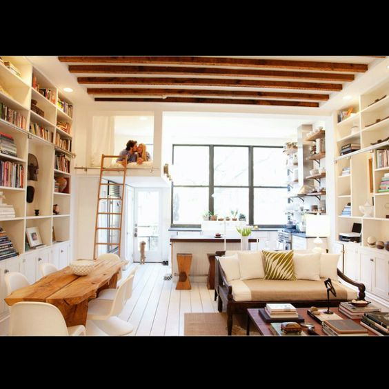 11-ideas-for-small-studio-apartments - Love the use of tall white bookcases on either side of room to help with storage in small place