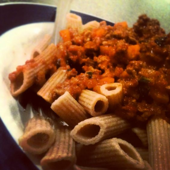 Grass fed beef bolognese made with organic tomatoes & more fresh basil from my garden, served with wholemeal penne