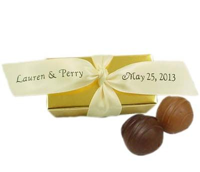 Only $2.30 Each!  Champagne Chocolate Truffle Favors.  See more here-  http://www.thechocolateshoppe.com/shoppe/product460.html