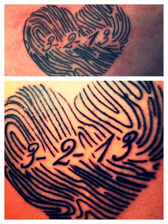 Mine and the hubby's matching tattoo. Our thumbprints in the shape of a heart with our wedding date.