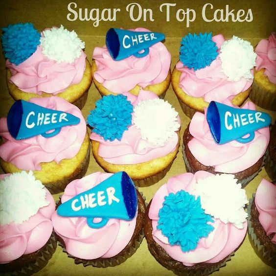 Cheerleading cupcakes with megaphones and pom-poms! Facebook.com/SugarOnTopCakes
