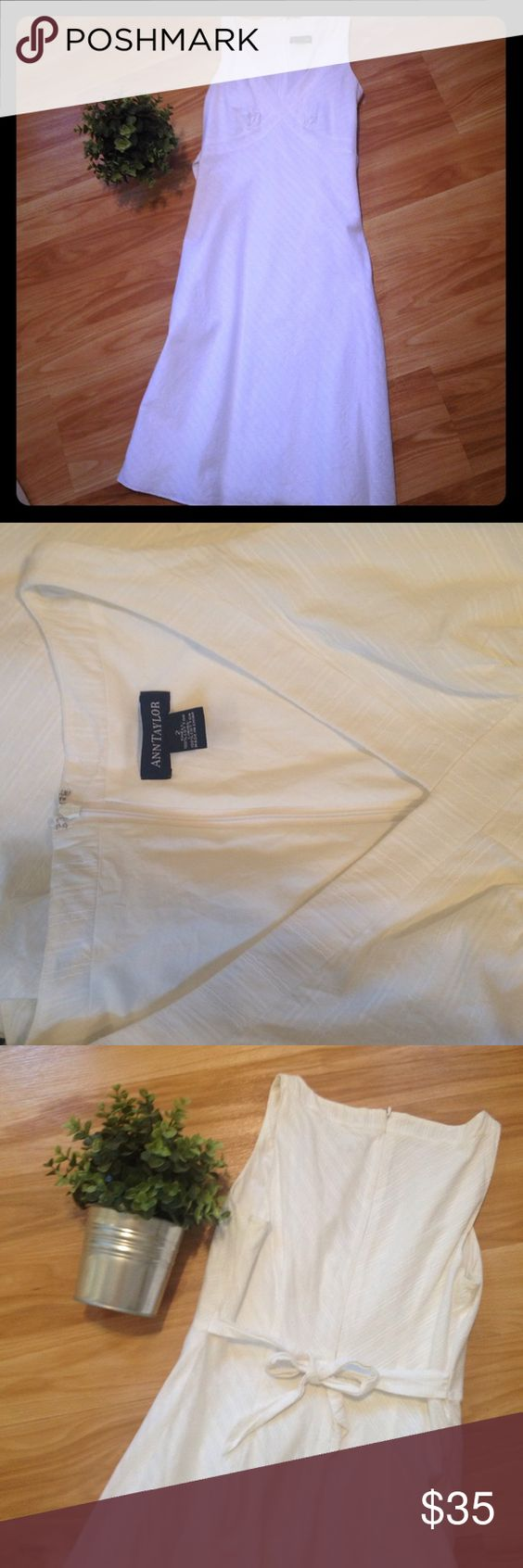 Ann Taylor white cotton dress Beautiful white cotton Ann Taylor Dress. Size 2. V- neck front. Ties at the waist in the back. Excellent condition! Ann Taylor Dresses Midi