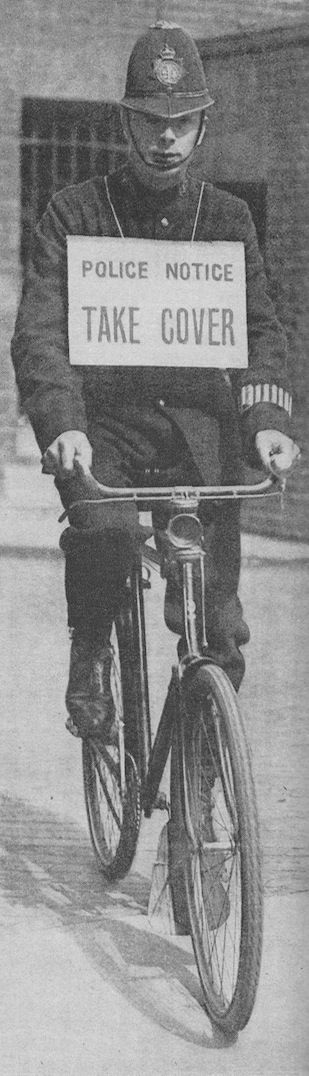"""In July, 1917, a new scheme for warning the people of London of impending air raids was adopted. When enemy aircraft were approaching, policemen with a notice warning passers-by to """"take cover"""" went out on bicycles, blowing their whistles to attract attention. When all danger had passed, Boy Scouts went round blowing bugles."""