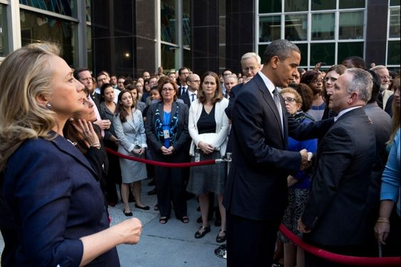 President Barack Obama greets State Department employees after speaking to them in a courtyard at the State Department in Washington, D.C., Sept. 12, 2012. Secretary of State Hillary Rodham Clinton stands at left. The President made the visit after Chris Stevens, U.S. Ambassador to Libya, and three others were killed at the consulate in Benghazi, Libya, yesterday.