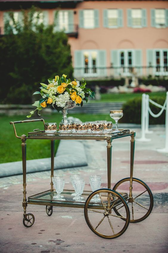 Gold Art Deco Bar Cart | Chicago Loyola University Cuneo Mansion Echoes The Beauty Of A Roaring 20s Wedding | Photograph by Ingrid Bonne Photography