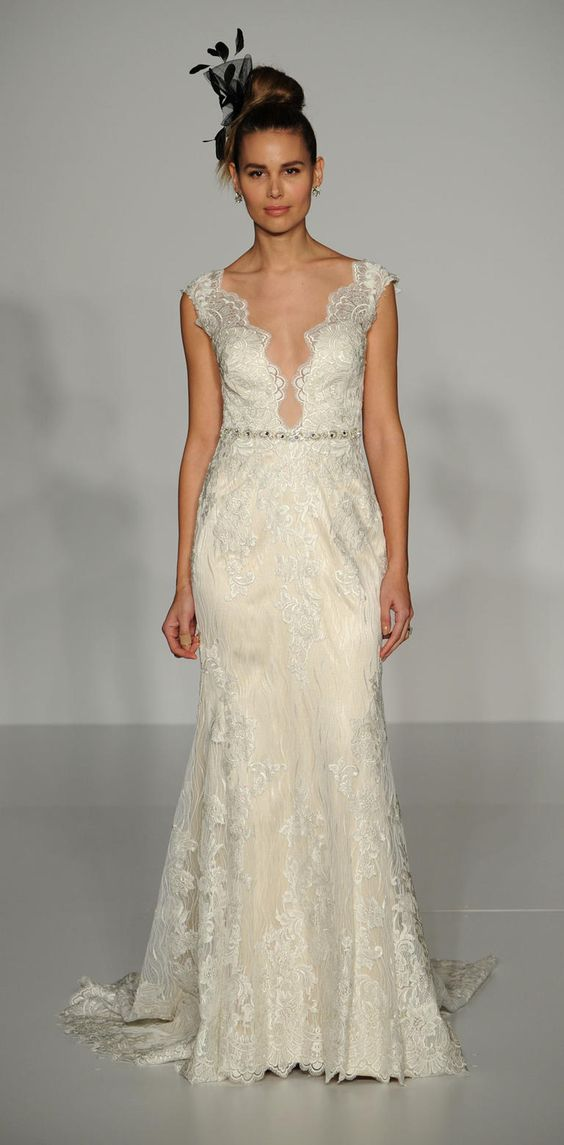 Ivory embroidered wedding dress with plunging neckline and belt detail