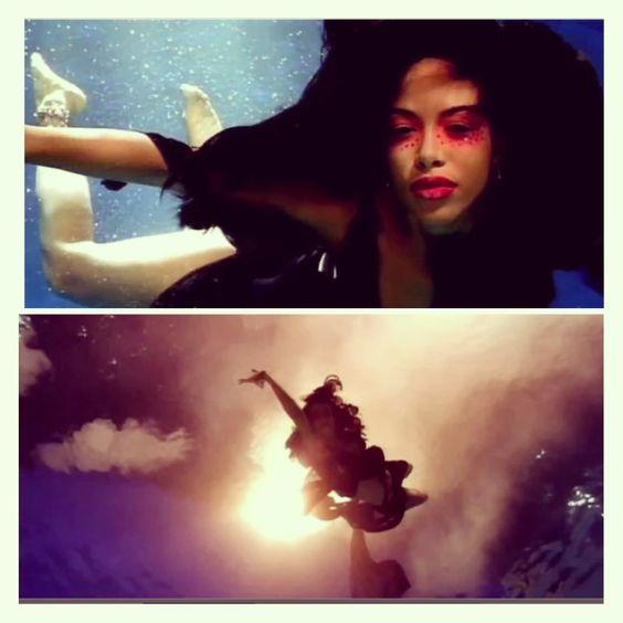 Aaliyah looks like a mermaid to me.I love this pic.. R.I.P.