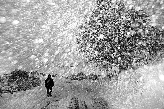 Snow Storm by Italian street photographer Donato Buccella: