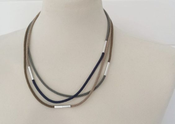 silk cord necklace with magnetic clasps that allow for many different configurations.  Tutorial