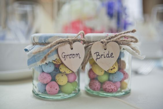Mini Eggs Easter Themed Wedding Favours and Place Names - jars with mini eggs, fabric, twine and wooden hearts. Bride and Groom. Homemade / DIY / Craft Project: