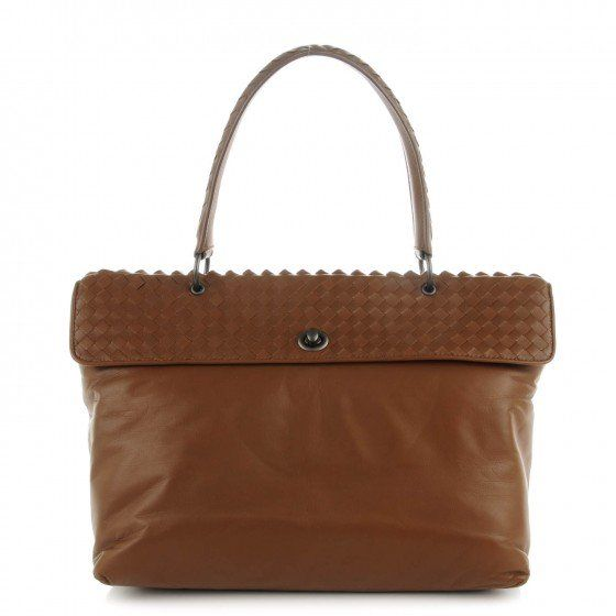 This is an authentic BOTTEGA VENETA Smooth Lambskin Intrecciato Tiina Top Handle Bag in Cigar. This stylish tote is crafted of finely textured leather.