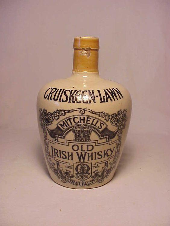 c1920 Cruiskeen Lawn Mitchells Old Irish Whisky Belfast . Cork Top Stoneware Whiskey Jug Bottle