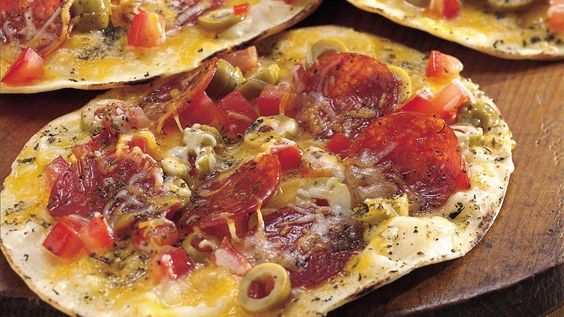 Grilled pizza?  It's easy when you build pizzas on tortillas. They grill up crisp and tasty in just six minutes.