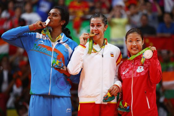 L-R) Silver medalist V. Sindhu Pusarla of India, gold medalist Carolina Marin of Spain and bronze medalist Nozomi Okuhara of Japan celebrate during the medal ceremony after the Women's Singles Badminton competition on Day 14 of the Rio 2016 Olympic Games at Riocentro - Pavilion 4 on August 19, 2016 in Rio de Janeiro, Brazil.