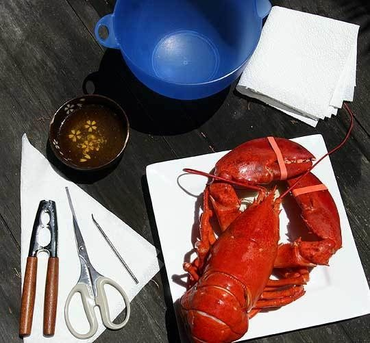 It's summertime, which means lobster prices have lowered and many people are enjoying eating these delectable crustaceans at clambakes and other al fresco situations. I just love sultry summer evenings, sitting on the back porch and digging into some freshly steamed lobster accompanied by a chilled pinot grigio, laughing with good friends. If this sounds good to you but you find the idea of eating a whole, uncracked lobster a bit intimidating, I hope the following guide will help to give you…