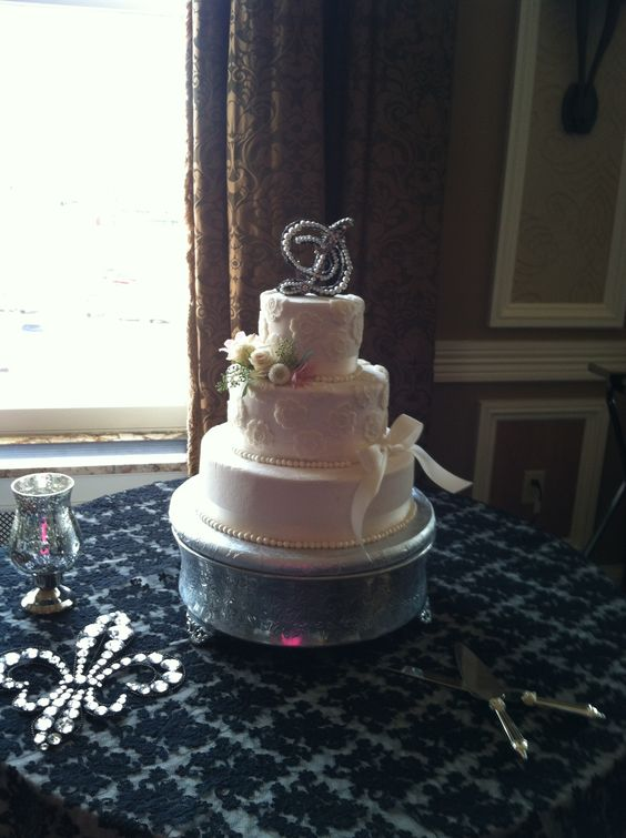 Wedding cake with jeweled cake topper