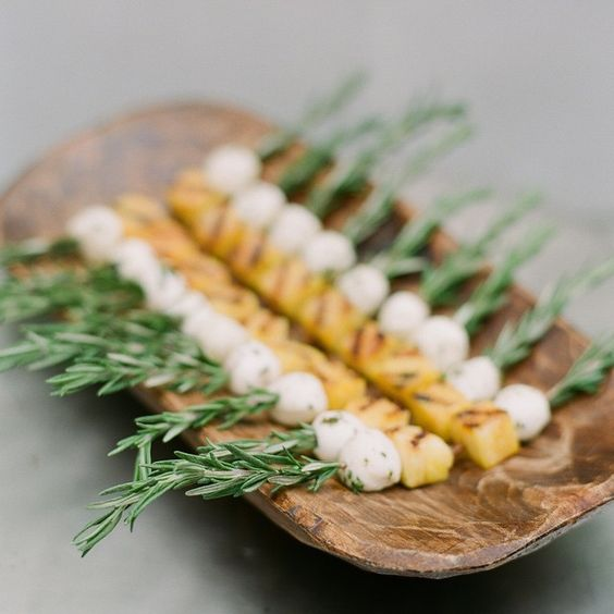 fresh mozzarella and grilled pineapple on rosemary skewer