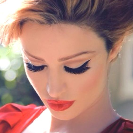 Gorgeous! Red lips and classic winged liner.