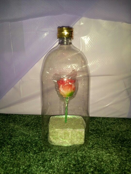 Beauty and the beast party decoration I also made..soda bottle , rose gold curling ribbon..also cheap & easy!