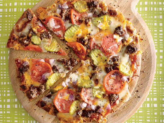 Our take on this guaranteed family favorite saves more than 200 calories, 16 grams of fat, and nearly 670 milligrams of sodium over the leading fast-food cheeseburger pizza.