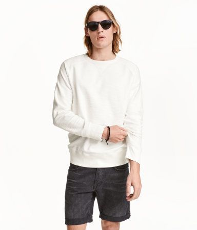 White. Top in inside-out cotton sweatshirt fabric with long raglan sleeves and ribbing at cuffs and hem.