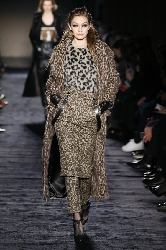 The model mixed and matched different color leopard prints on the Max Mara runway. Image Sourc...