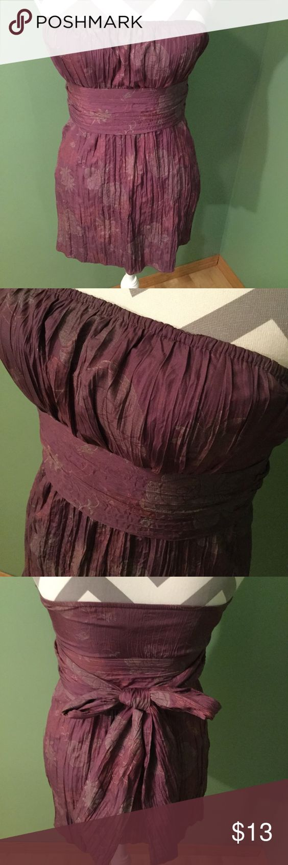 Strapless Dressy Top Beautiful plum colored strapless top, zips on the side. Ties in the back or front. Fabric has a shine to it, but it's not scratchy. Charlotte Russe Tops Tunics