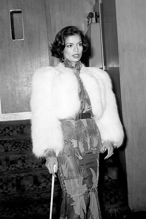 Bianca Jagger knew how to turn heads in her floral ensemble and fur coat.