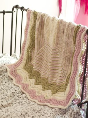 I absolutely LOVE this blanket.  I like that the pink and green are both sort of subtle, and I like the contrast of the thin and thick stripes of color.  I know of a little girl due to join the world in June, and I think this would be a lovely welcome gift.