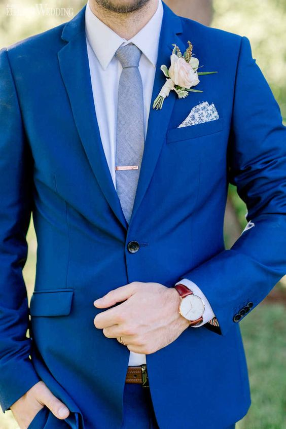 Blue Groom Suit with Blush Pink Boutonniere | A Boho Wedding Featuring a Triangle Arch | ElegantWedding.ca