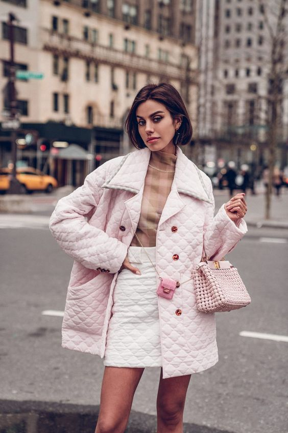 Pretty in pink! Love this all Fendi look I wore to their NYC event to celebrate the launch of the SS20 collection. Wearing a quilted pink jacket and quilted white skirt, gingham print sheer turtleneck, peekaboo woven leather handbag, and bag charm worn crossbody #fendi #outfit #outfitidea #quiltedjacket #quiltedskirt #miniskirt #peekaboo