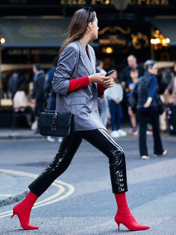 The major boot trend at London Fashion Week so far? Zara's red sock ankle boots, of course. See who's wearing them right now and where to shop them...