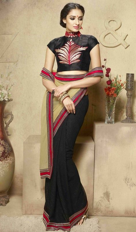 Fashion and trend would be on peak of your magnificence as soon as you dresses this beige and black color silk half n half sari. This attractive attire is displaying some astounding embroidery done with resham, stones and unique border work.  #adorablelooksaree #designersaris #blacksilksarees