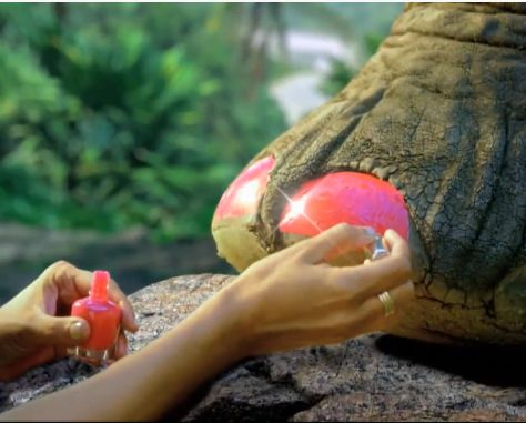 Who's that painting an elephant's toenails? Katy Perry, that's who...