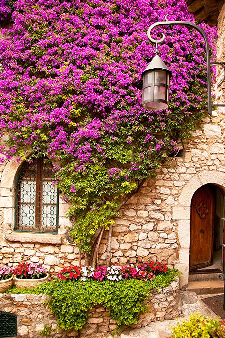 Eze, France Another great entrance to come home to. Love the stone, the flowers, the door and that wonderful gated window
