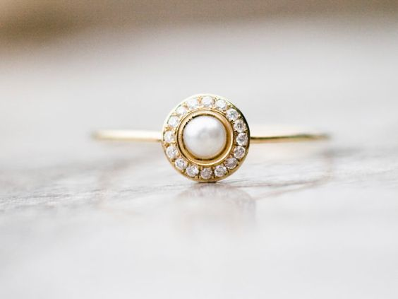 Hey, I found this really awesome Etsy listing at https://www.etsy.com/uk/listing/207357978/white-pearl-wedding-ring-with-diamonds