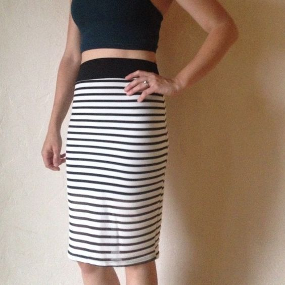 Black & White Striped High Waisted Pencil Skirt Black and white high waisted pencil skirt. Can be worn with nice blouse to work or with a crop top (as pictured) for a more casual look. Inside is lined to a mini skirt length, so bottom 1/3 has a peekaboo effect. Skirts Pencil