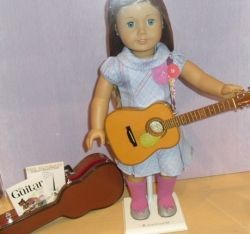 That's not my niece's doll, but it's her doll's guitar: the one that I took two buses up to the Seattle suburbs to get for her. Chelsea caught...