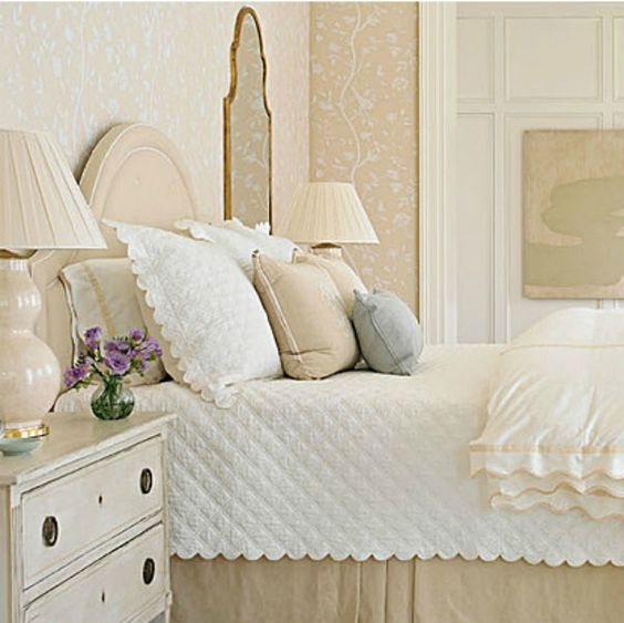 Interior design ideas photo gallery featuring beautiful bedroom decor with romantic style and interior design by Phoebe Howard. Scalloped edge on quilt, neutral tones, and light blue accents create a calm serene mood. Romantic European Farmhouse Bedroom Decor Ideas!#bedroom #interiordesign #romantic #traditional #decor